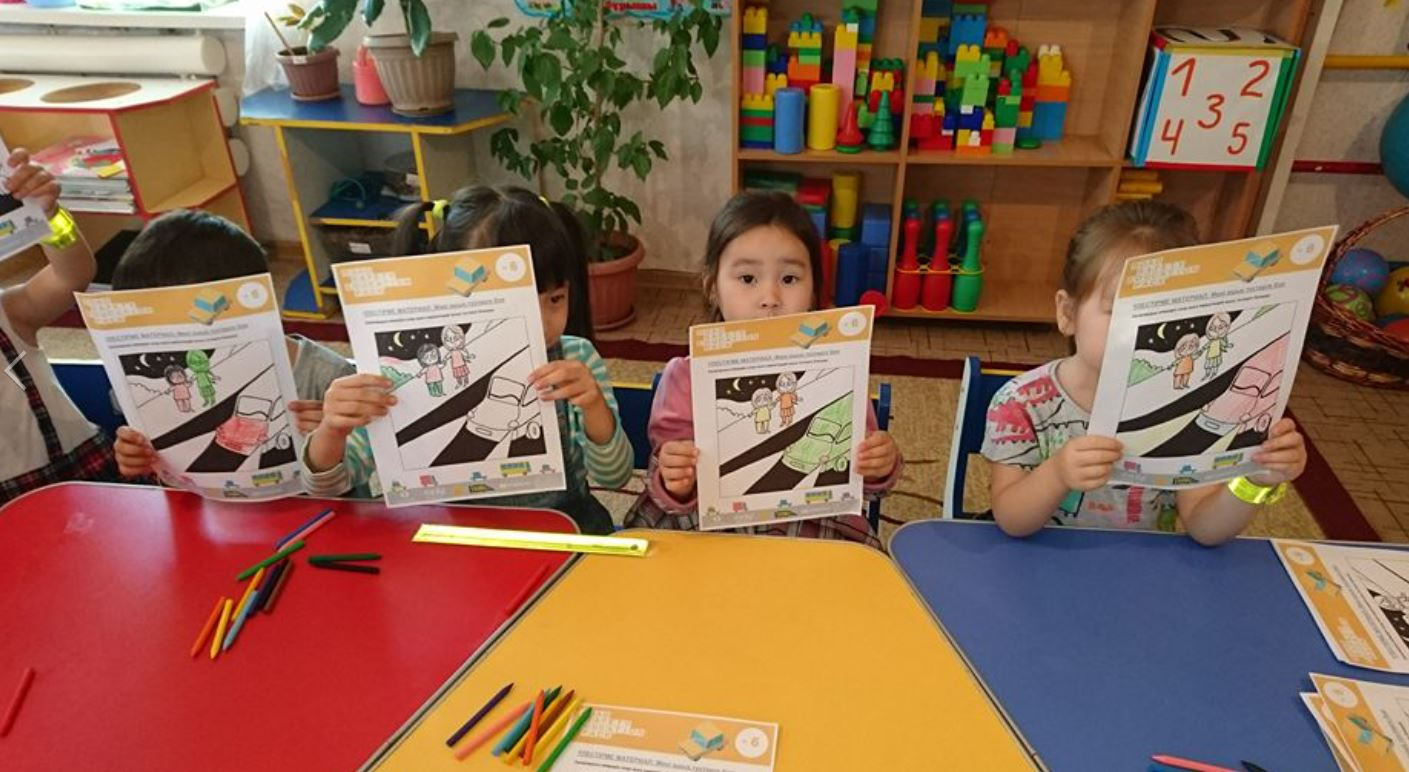 Children in Kazakhstan with road safety artwork
